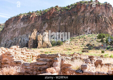 Canyon and old pueblo stone ruins at Main Loop trail in Bandelier National Monument in New Mexico during summer in Los Alamos - Stock Image