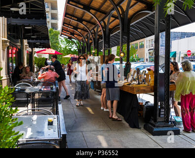 ASHEVILLE, NC, USA-10 JUNE 18:  A covered outside sales and dining area at the Grove Arcade, where local craftsmen display their wares. - Stock Image