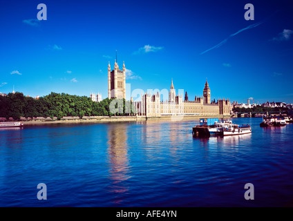 Wide angle view of the Houses of Parliament (Palace of Westminster) from south side of River Thames - Stock Image