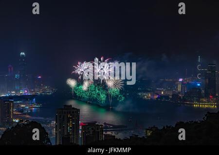 Hong Kong. 01st July, 2017. Fireworks at Victoria Harbour, Hong Kong. Commemorating 20th anniversary of Hong Kong - Stock Image