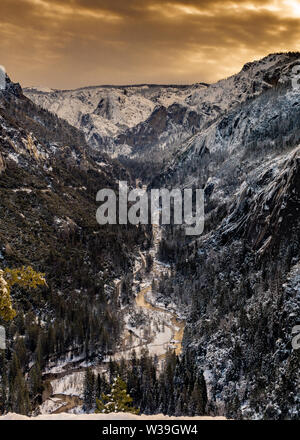 View of the Merced River from Higway 120 and the valley below, Yosemite National Park, on a winter day in the evening, featuring warm colors - Stock Image