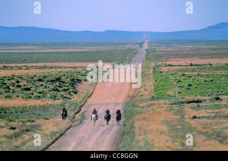 Horseback riders travel on reservation road during 'Water Is Life' ride, near Cottonwood, Navajo Indian - Stock Image
