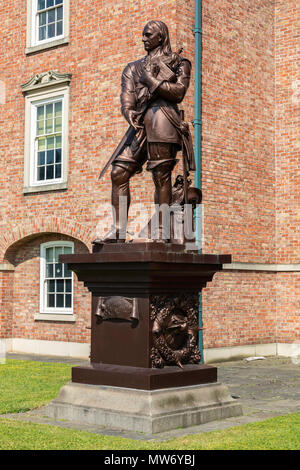 A Grade II listed statue of Oliver Cromwell  on a plinth in the grounds of the Warrington Academy Building Warrington Cheshire May 2018 - Stock Image