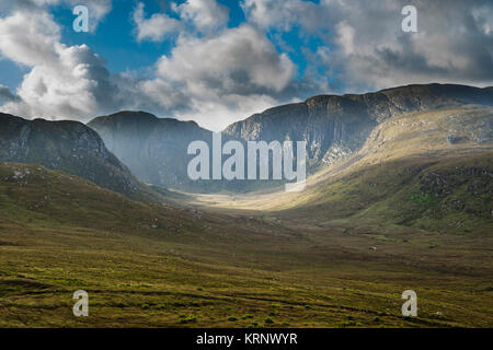 Early morning sunshine lighting the huge glacial corrie formed of Main Donegal Granite in the Poison Glen, Dunlewy, - Stock Image