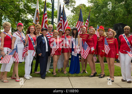 Merrick, New York, U.S. - May 26, 2014 - JANE RUBINSTEIN, 62, Ms. New York Senior America, is at center in blue gown, flanked by former Ms. New York Senior Americas and senior dancers in red costumes, at The Merrick Memorial Day Parade and Ceremony, hosted by American Legion Post 1282 of Merrick, honoring those who died in war while serving in the United States military. Rubinstein is from Merrick. Credit:  Ann E Parry/Alamy Live News - Stock Image