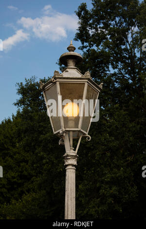 Detail of german streetlamps with sky in background. - Stock Image