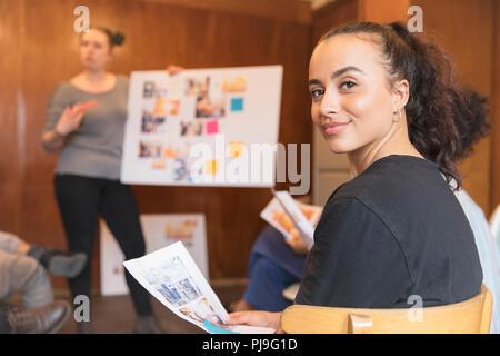 Portrait confident creative female designer in meeting - Stock Image
