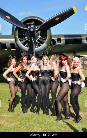 Playboy Bunny girls at Goodwood Revival in front of Boeing B-17 Flying Fortress Sally B. Plane engine - Stock Image