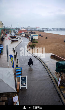 Brighton, UK. 09th Apr, 2019.  A grey wet day along Brighton seafront on the south coast today but the forecast is set to improve over the next few days throughout Britain Credit: Simon Dack/Alamy Live News - Stock Image