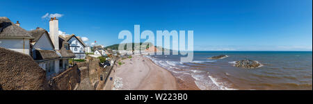 Panoramic view of seafront, beach and coastline of Sidmouth, a small popular south coast seaside town in Devon, south-west England - Stock Image