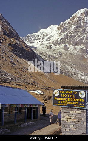 Hotel Paradise Garden Guest House and Restaurant Base Camp with helicopter and Annapurna South Nepal Himalayas - Stock Image