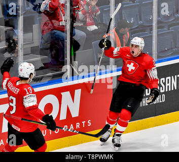 Bratislava, Slovakia. 14th May, 2019. Swiss ice hockey players NICO HISCHIER, KEVIN FIALA (right) celebrate a goal in action during the match Switzerland against Austria at the 2019 IIHF World Championship in Bratislava, Slovakia, on May 14, 2019. Credit: Vit Simanek/CTK Photo/Alamy Live News - Stock Image