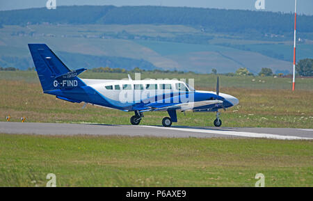 A Cessna 406 of Atlantic Airlines Ltd approaching/landing at Inverness Dalcross Airport in Northern Scotland. - Stock Image