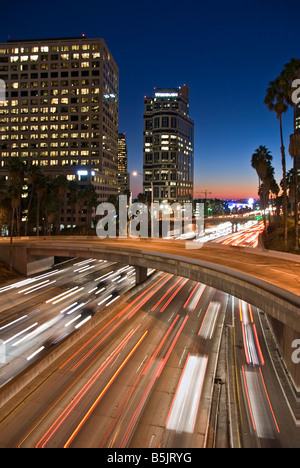 US 101, Harbor Freeway LA skyline, Dusk Los Angeles, California, USA Traffic moving CA economic, cultural, entertainment - Stock Image