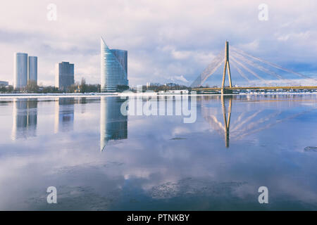 Riga embankment with reflection in the river - Stock Image