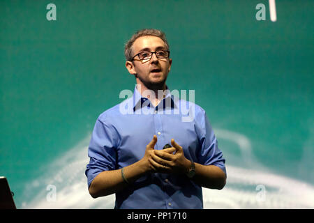 Nuclear Physicist, David Mahon explaining how  muon particles from space can be used to illuminate secrets buried in the pyramids and elsewhere, on the Technology Stage, at New Scientist Live - Stock Image