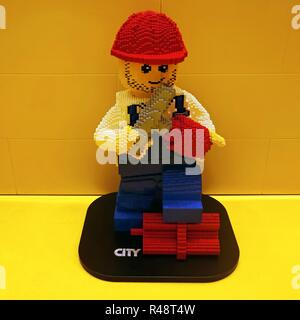 A large 'builder' figure assembled from the City collection of Lego building bricks - Stock Image