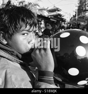 Boy with balloon - Stock Image