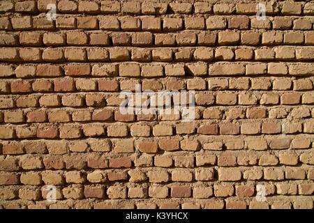 Bricks in a brick and mortar wall. - Stock Image