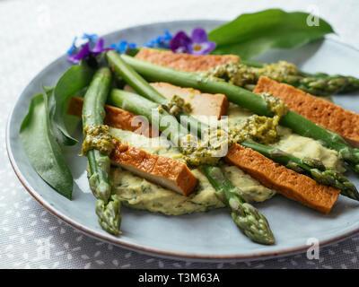 Wild Garlic Hummus with Asparagus, Smokey Tofu and Coriander Pesto - Stock Image