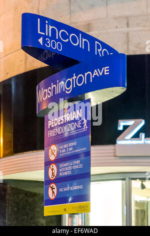 Blue street signs identifying Lincoln Road and Washington Avenue as pedestrian friendly zone on Miami Beach, Florida - Stock Image