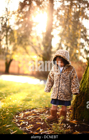 Young girl by trees in Fall - Stock Image