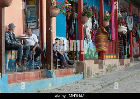 The locals outside a bar in Raquira, Boyaca, Colombia - Stock Image