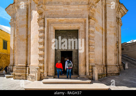 Matera, Italy - September 23 2018: A young tourist couple enter the medieval Chiesa del Purgatorio church in Matera, Italy - Stock Image
