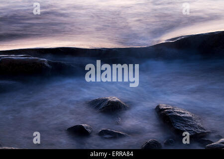Stones in the water's edge - Stock Image