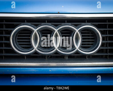 Audi Car Badge, made from four rings that represent the car companies that came together to form the company in 1910. - Stock Image