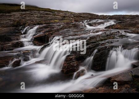 Mountain river above lake Teusajaure, Kungsleden trail, Lapland, Sweden - Stock Image