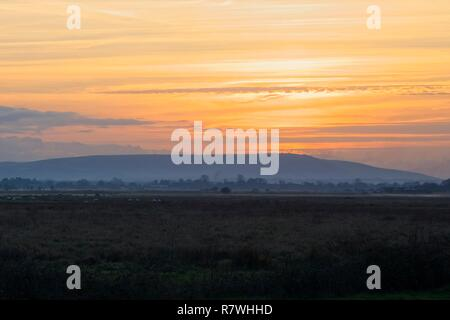 Pevensey Levels, UK. 11th Dec 2018.UK weather. Mist forms at sunset on the Pevensey Levels after a cold but bright day in East Sussex, UK. Credit: Ed Brown/Alamy Live News - Stock Image