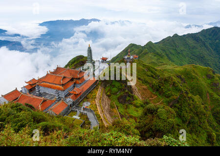 Stunning view of mountains and the temple from the summit of the Fansipan Mountain, Sapa, Lao Cai, Vietnam - Stock Image
