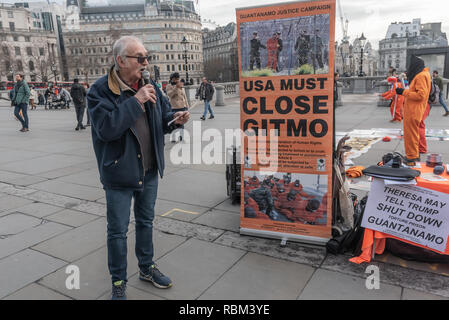 London, UK. 11th January 2019. Ray Silk of the Guantanamo Justice Campaign speaks at the protest to mark the 17th anniversary of the first prisoners arriving at the illegal US camp. There was a display of poster, photographs of the remaining detainees, readings and speeches in Trafalgar Square to highlight the abuse, torture, lack of human rights, force-feeding and indefinite detention there and call for its closure. Credit: Peter Marshall/Alamy Live News - Stock Image