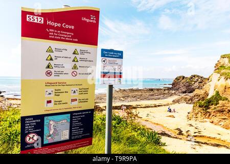 Hope Cove, Devon, UK, England, Hope Cove Devon, Hope Cove beach sign, warnings, warning, Hope Cove lifeguard sign, Hope Cove warning sign, sign, Sign - Stock Image