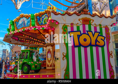 Fun fair in a city centre. - Stock Image