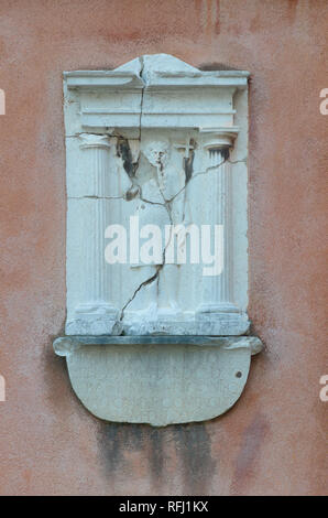 broken relief statue in Venice - Stock Image