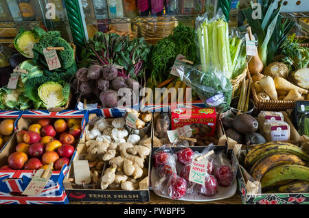 An attractive display of winter fruit and vegetables with 2018 price tickets in a greengrocer's shop in North Yorkshire - Stock Image