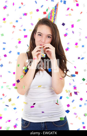 Stock image of casual teen in a party with hat and blowout over white background - Stock Image