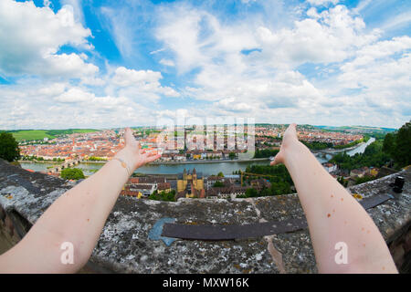 First person view from Festung Marienberg with arms in foreground on Würzburg, Germany - Stock Image
