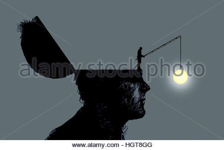 Light bulb dangling on fishing line from inside of man's head - Stock Image