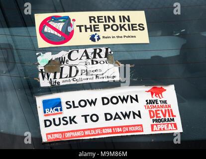 Political stickers stuck on a car window in Hobart, Tasmania, Australia - Stock Image
