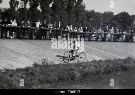 1950s, cycle race on a banked track, rider on a tandem. - Stock Image