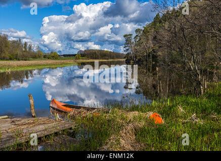 Old canoe at Svartan stream outside Mjolby, Ostergotland, Sweden - Stock Image