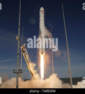 The Northrop Grumman Antares rocket, with Cygnus resupply spacecraft onboard, blasts off from Pad-0A at the NASA Wallops Flight Facility April 17, 2019  in Wallops, Virginia. The commercial resupply cargo mission will carry 7,600 pounds of science and research, crew supplies and vehicle hardware to the International Space Station. - Stock Image