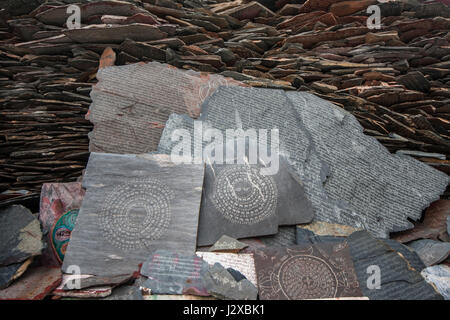 Pile of Mani stone plates enroute Lingkhor kora, Lhasa, Tibet. - Stock Image