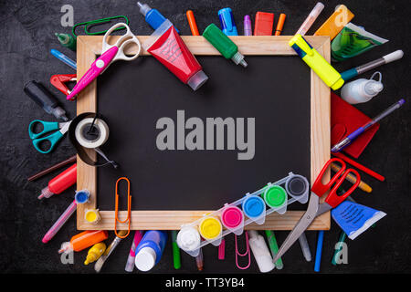 Back to School Concept with Stationery Supplies and Blackboard - Stock Image