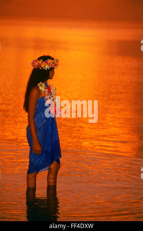 Polynesian girl in shallow waters at Aitutaki in Cook Islands  South Pacific - Stock Image