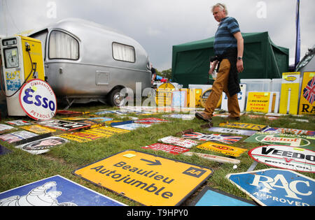 A person looks at road signs for sale at the Spring Autojumble at the National Motor Museum in Beaulieu, Hampshire. - Stock Image