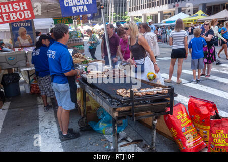 Chicken pita food stands in the 6th Avenue that was closing to car only for pedestrian in Manhattan, New York, USA - Stock Image